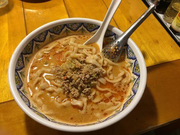 「タンタン麺(刀切麺)¥940」@中国ラーメン 揚州商人 北浦和店の写真